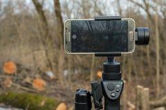 Галактика S6 прибора и Samsung gimball DJI Osmo передвижная знонит по телефону Стоковая Фотография