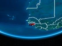Гвинея-Бисау на земле планеты от космоса на ноче Стоковое Изображение RF