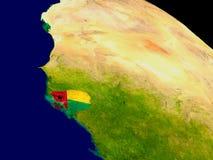 Гвинея-Бисау с флагом на земле Стоковое Изображение RF