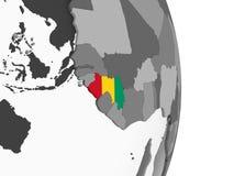 Гвинея с флагом на глобусе иллюстрация штока
