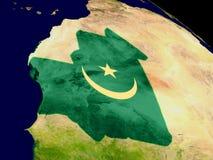 Гвинея с флагом на земле Стоковая Фотография