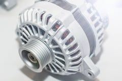 Генератор энергии на белой предпосылке Инженерство части автомобиля Светлое фото Стоковая Фотография RF