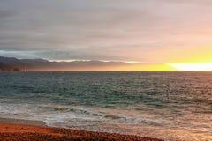 Гениальный заход солнца над океаном и горами, заливом Banderas Мексики Стоковая Фотография