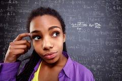 Гений девушки в образовании назад к школе стоковые изображения rf