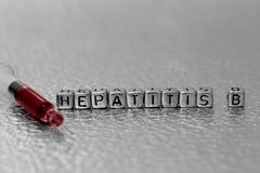 Гепатит B на шариках с кровью в шприце Стоковая Фотография RF