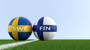Германия Швеция против Футбольный матч Финляндии - футбольные мячи в цветах Швеции и Finlands национальных на футбольном поле Стоковые Фотографии RF
