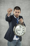 Герой, бизнесмен и часы времени стоковая фотография rf