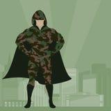 Герой в камуфляжной форме на векторе предпосылки города Стоковое Фото