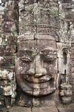 Гигантские каменные стороны на Prasat Bayon, Angkor Wat Стоковое Изображение RF