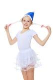 Гимнаст девушки в клобуке Санта Клаусе Стоковые Изображения RF