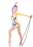 гимнаст девушки над белой предпосылкой Стоковое Изображение