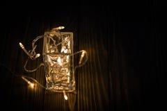 Гирлянда в стекле На nighttime Стоковое Изображение RF