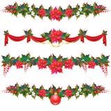 Гирлянда рождества, шарики, красные смычки, на белизне Стоковое фото RF