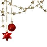 Гирлянды рождества с звездами и красными украшениями Стоковая Фотография