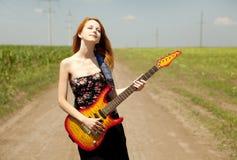 гитара девушки сельской местности Стоковое фото RF