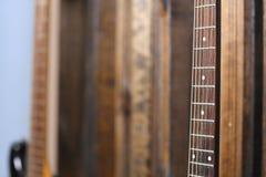 Гитара на стене Стоковые Изображения RF