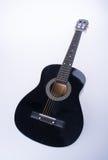 гитары или черные гитары цвета на предпосылке Стоковое Изображение RF