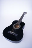 гитары или черные гитары цвета на предпосылке Стоковые Изображения RF
