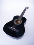 гитары или черные гитары цвета на предпосылке Стоковые Фото
