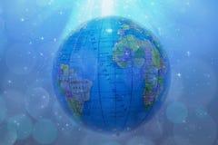 Глобус земли с звездами и межзвёздным облаком фона Стоковые Изображения RF