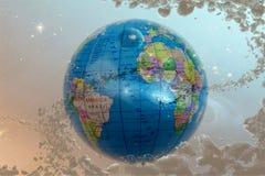 Глобус земли с звездами и межзвёздным облаком фона Стоковое Изображение