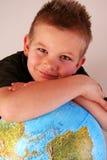 глобус мальчика его Стоковая Фотография RF