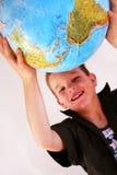 глобус мальчика стоковое изображение rf