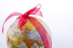 Глобус связанный с лентой стоковая фотография rf