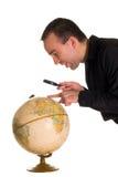 глобус смотря человека Стоковое Изображение RF