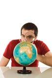 глобус смотря человека Стоковые Изображения