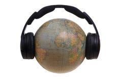 Глобус с наушниками стоковое фото rf