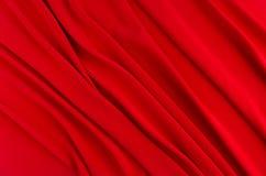 Глубоко - красная silk ровная предпосылка с космосом экземпляра Абстрактный фон влюбленности страсти стоковые изображения