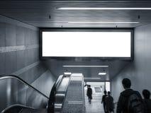 Глумитесь вверх по знамени в метро с идти людей эскалатора Стоковое фото RF