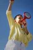 говорить громкоговорителя ребенка Стоковая Фотография