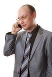 говорить костюма телефона бизнесмена Стоковое Фото