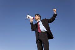 говорить мегафона бизнесмена Стоковое Фото