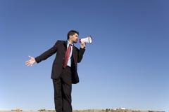 говорить мегафона бизнесмена Стоковые Фотографии RF