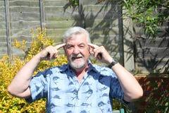 Говорить старшего человека думает Стоковое Фото