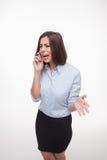 Говоря бизнес-леди на белой предпосылке Стоковые Фото