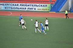 Год 8-ое июня 2017 †Оренбурга, России «: Футбол игры мальчиков Стоковое фото RF