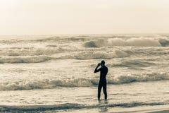 Год сбора винограда заплыва океана пляжа спортсмена стоковая фотография