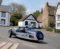 Год сбора винограда 3-катил автомобиль увиденный принять угол на скорость стоковая фотография rf