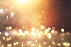 Год сбора винограда яркого блеска освещает предпосылку серебр, чернота и золото де-сфокусированный стоковые изображения rf