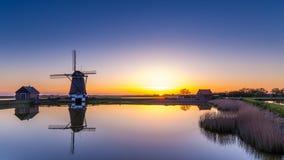 Голландская ветрянка во время захода солнца Стоковое фото RF