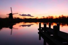 Голландская ветрянка на заходе солнца Стоковая Фотография RF