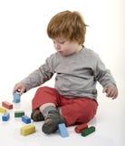 головка мальчика играя красный цвет Стоковые Фото