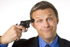 головка пушки бизнесмена держа к стоковая фотография rf