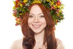 головка цветка над белым венком Стоковые Фото