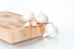 Головки чеснока на белизне Стоковая Фотография RF