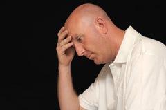 головной человек удерживания унылый Стоковое Изображение RF